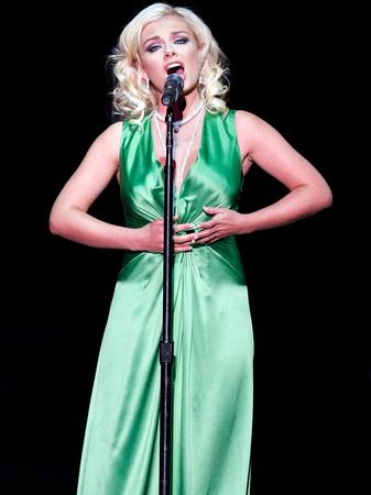 Katherine jenkins singing at the 'Hit Man'