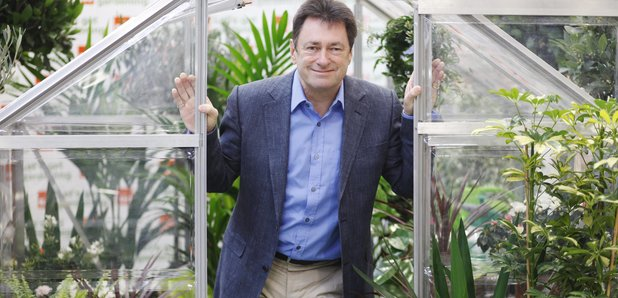 Alan Titchmarsh in a greenhouse