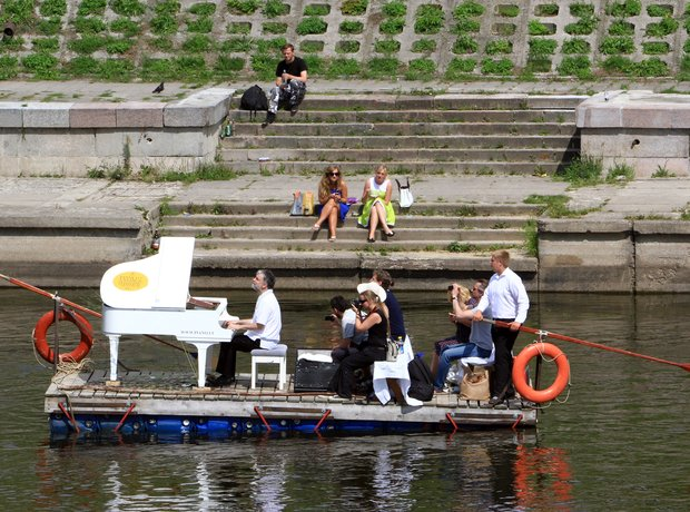Petras Geniusas performs on a river