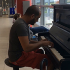 man plays beethoven at airport