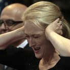 Meryl Streep covering ears